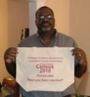 Graylin Presbury, President of Fairlawn Citizens Association, holds reuseable canvas Census Complete Count bag.