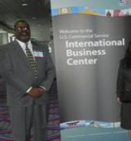 Graylin Presbury poses next to International Business Center sign at International Buyer Program trade event.